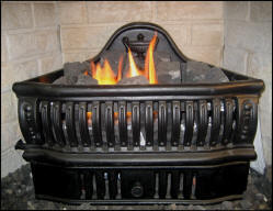 Vent free gas coal grates with regular front create old world look in small new fireplace construction